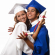 College graduates in cap and gown - Foto Stock