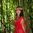 Polynesian woman in a bamboo forest — Stock Photo