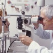 Optometrist with patient - Foto Stock