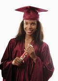 キャップとガウンの女性の大学を卒業 — ストック写真