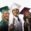 Three graduates in cap and gown — Stock Photo