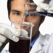 Lab technician with beaker and flask — Foto Stock