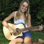 Beautiful teenage girl playing guitar — Stock Photo #3568030