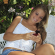 Beautiful teenage girl texting on her cell phone — Stock Photo #3568031