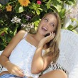 Eenage girl calling on her cell phone — Foto Stock