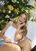 Eenage girl calling on her cell phone — Stock Photo