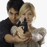 Man and woman with handgun — Stock Photo