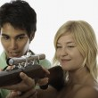 Man and woman with rifle — Stock Photo