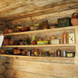 Ancient shelf for kitchen utensils. - Photo
