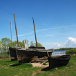 Ancient fishermens boats on the coast - Stock Photo