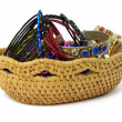 Stock Photo: Wicker case with beads and bracelets