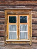 Window in old wooden wall — Stock Photo