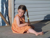 The little girl on a summer verandah — Stock Photo