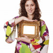 Woman holding an picture frame — ストック写真