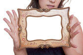 Woman holding an empty picture frame — Stock Photo