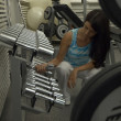Woman in Gym - Foto Stock