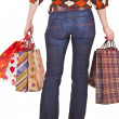 Happy woman holding shopping bags — Stock Photo #2937894