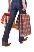 Happy woman holding shopping bags — Stock Photo