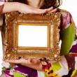 Royalty-Free Stock Photo: Woman holding an picture frame