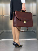 Business woman with hand-bag — Stock Photo
