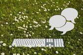 Chat clouds and keyboard — Stock Photo