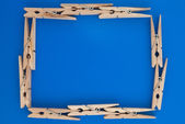 Frame made of wooden clothes pegs — Stock Photo