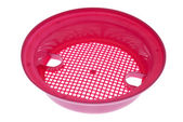 Pink plastic sand sieve — Stock Photo