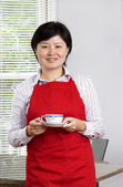 Housewife and tea — Stock Photo