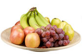 Fruits in a wood plate — Stock Photo
