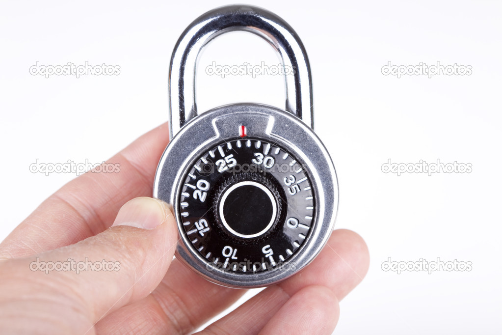A man's hand holding a lock — Stock Photo #2834610