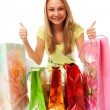 The beautiful girl with packages — Stock Photo