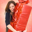 Stock Photo: The young girl with the big gift