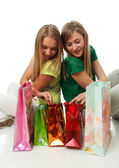 Two beautiful girls with packages — Stock Photo