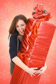 The young girl with the big gift — Stock Photo