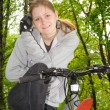 Stock Photo: Young girl on bike