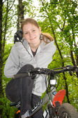 The young girl on a bike — Stock Photo