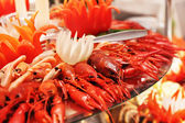 Lobsters, crabs and crawfish on a plate — Stock Photo