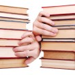 Pile of old books and hand — Stockfoto
