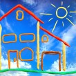 Plasticine cottage and sun - Stock Photo