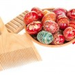 Easter eggs, coral necklace and comb — Stock Photo #2863013