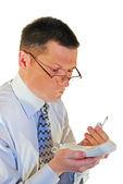 Homem de óculos com um telefone — Fotografia Stock