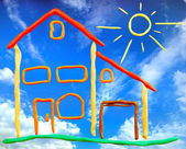 Plasticine cottage and sun — Stock Photo