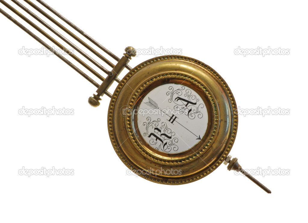 The pendulum (detail) of age-old mechanical clock isolated on a white background  Stock Photo #2861001