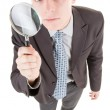 Man and magnifier — Stock Photo