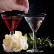 Rose and two glasses of cocktails - Stock Photo