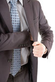 Businessman reaching out to his pocket — Stock Photo