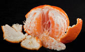 Partially peeled orange — Stock Photo