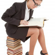 Woman and a pile of books — Stock Photo