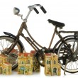 A toy bicycle and small toy town - Stock Photo