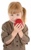Baby girl with apple — Stock Photo
